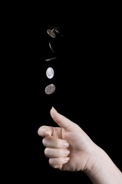 Tossing a coin resulting in head or tail with each outcome given by 50% chance