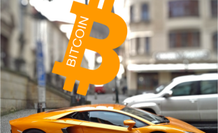 Bitcoin and auto parts.   What car is shown in the photo?