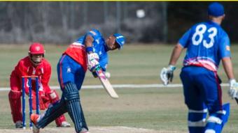 Cayman Islands vs Bermuda cricket match .