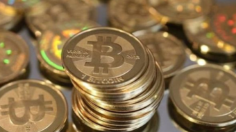 Bitcoin currency trading advises economists to be cautious