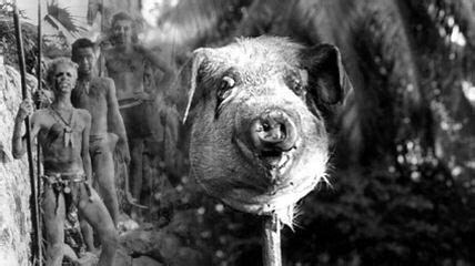A severed pig's head with little boys behind it