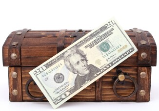 treasure chest with 20 dollar bill in front