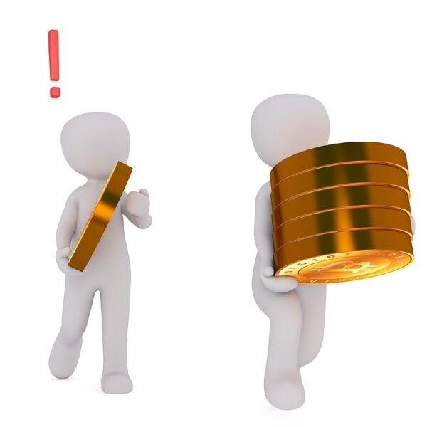 two figures carrying bitcoin coins