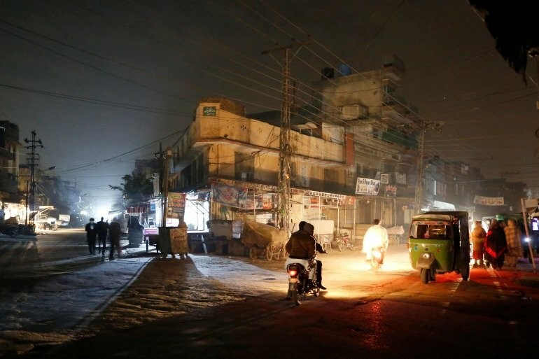 a dark street during widespread power outages in Rawalpindi, Pakistan