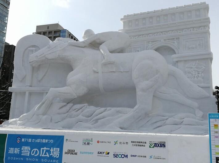 snow horse rider sculpture