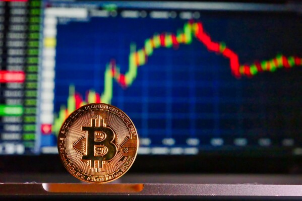 bitcoin in front of cryptocurrency trading platform