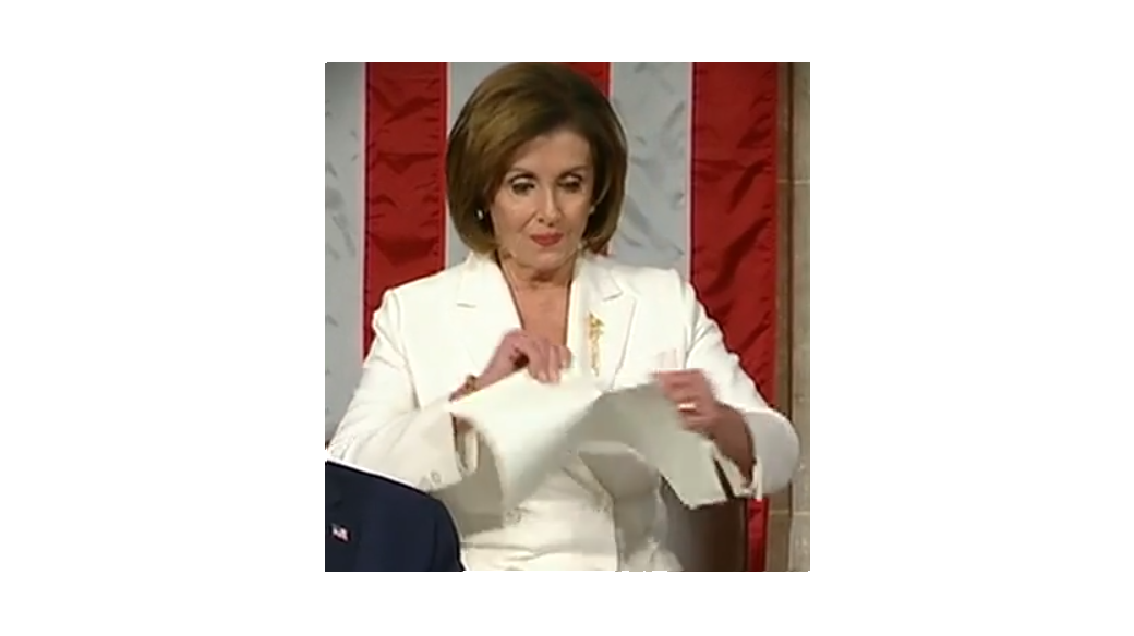 Nancy Pelosi trying her best to rip the paper but forgetting to look into the camera and at the POTUS while doing it. FAIL.