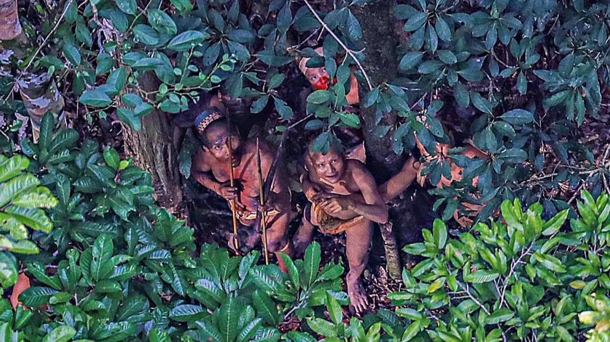 Photo of two people from an uncontacted tribe in the Amazon rainforest.