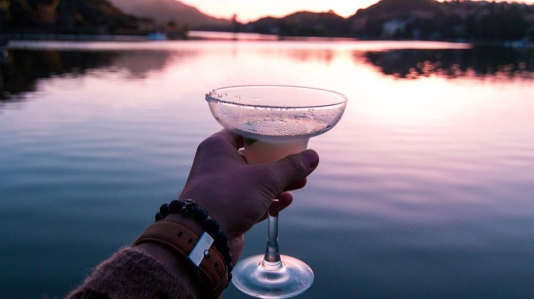 Holding a Margarita at the lake