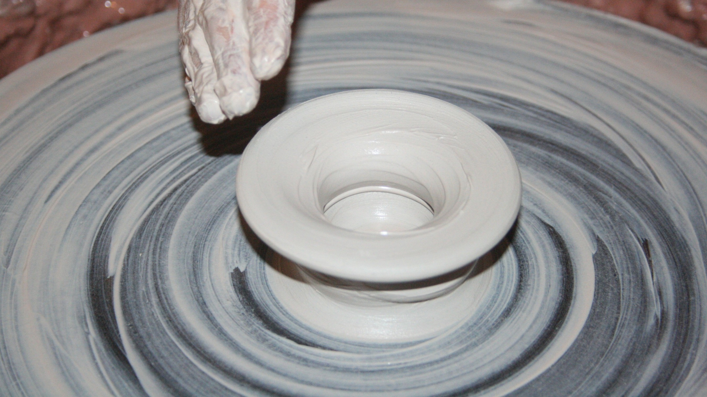 https://www.pexels.com/photo/person-making-clay-pot-162574/