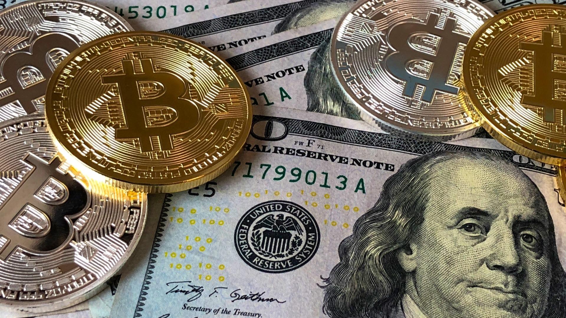 https://www.pexels.com/photo/bitcoins-and-u-s-dollar-bills-730547/