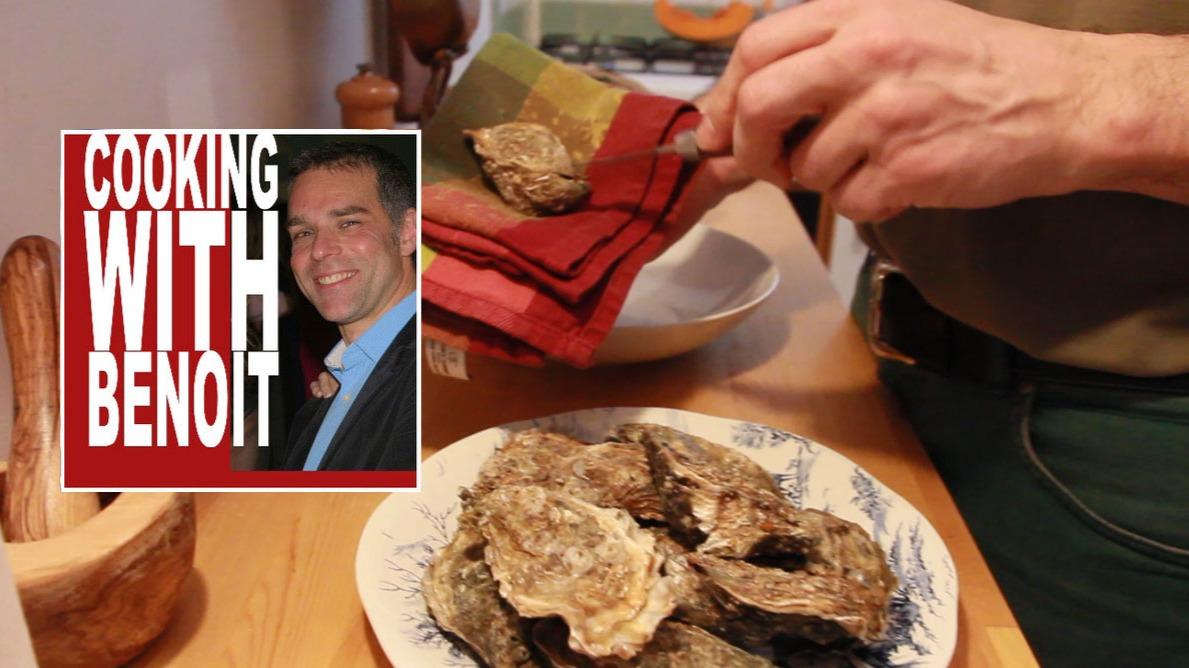 Benoit shucking an oyster