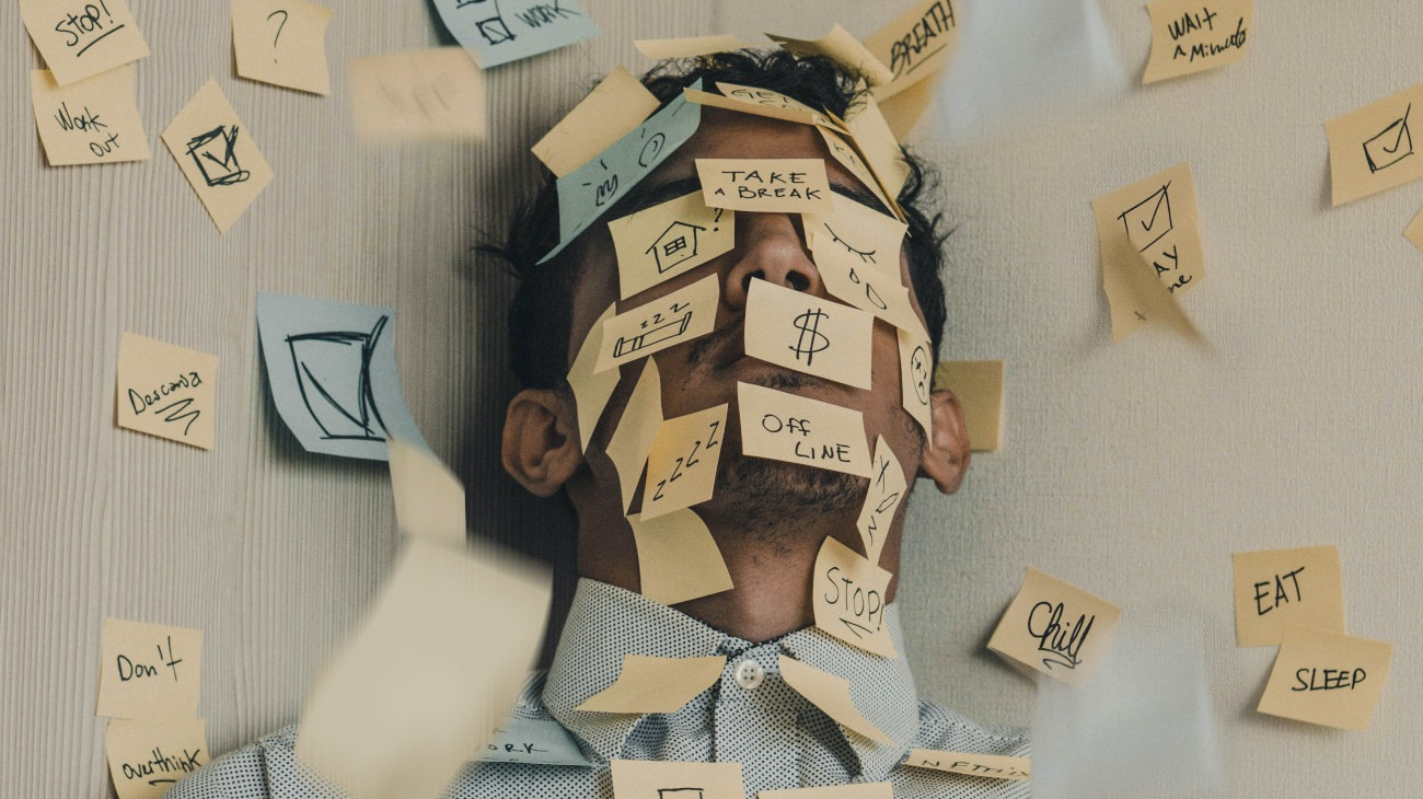 Man covered in to-do sticky notes