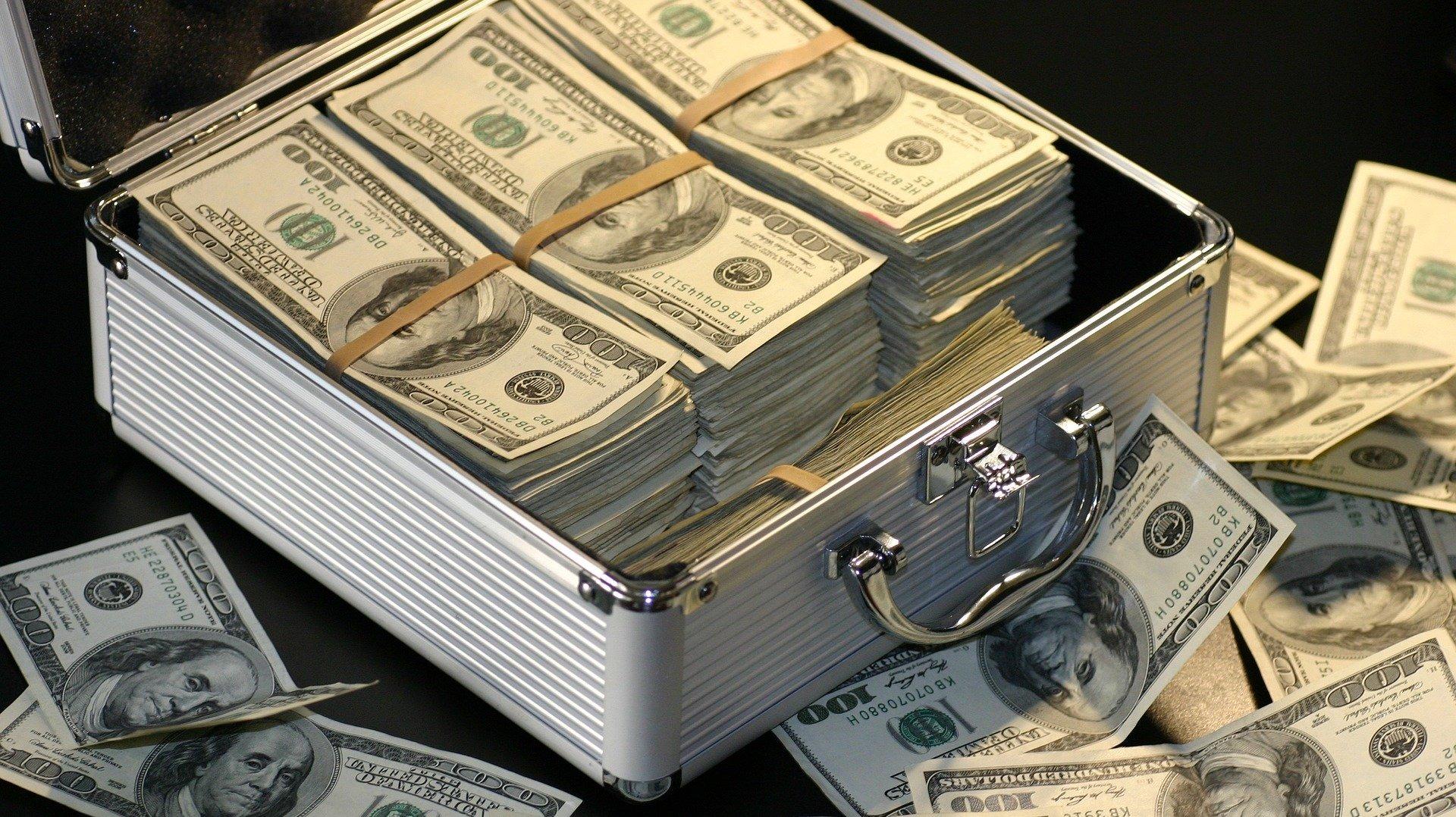 https://pixabay.com/photos/money-dollars-success-business-1428594/
