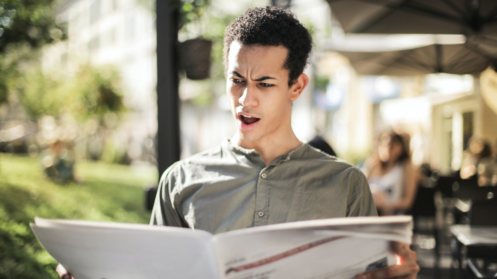 https://www.pexels.com/photo/selective-focus-photo-of-surprised-man-in-green-button-up-shirt-reading-newspaper-3765037/
