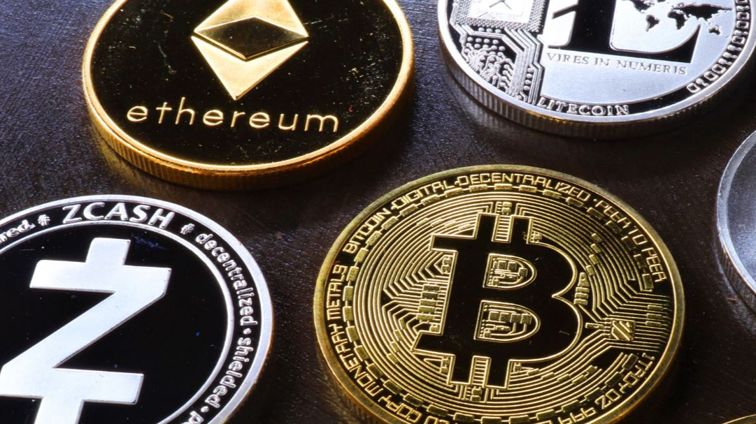 https://www.pexels.com/photo/various-cryptocurrency-on-table-5126268/