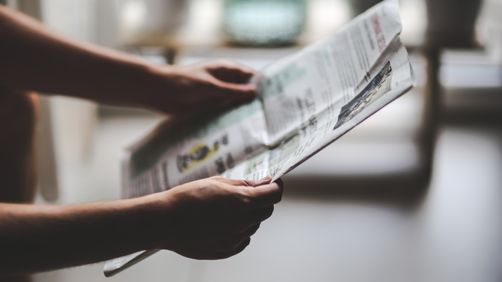 https://www.pexels.com/photo/man-reading-newspaper-6053/