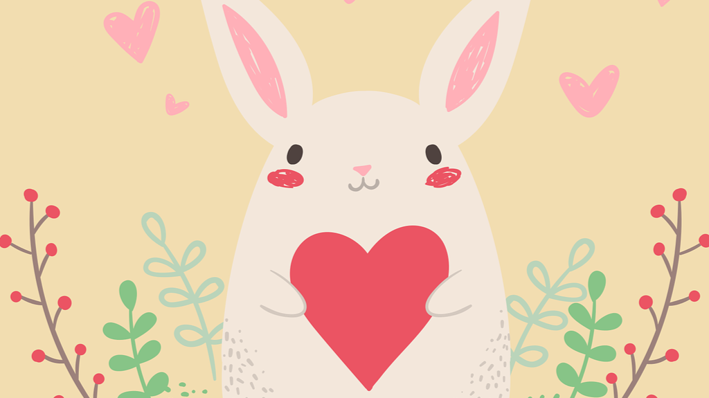 free use image from Pixabay of a bunny holding a valentine heart