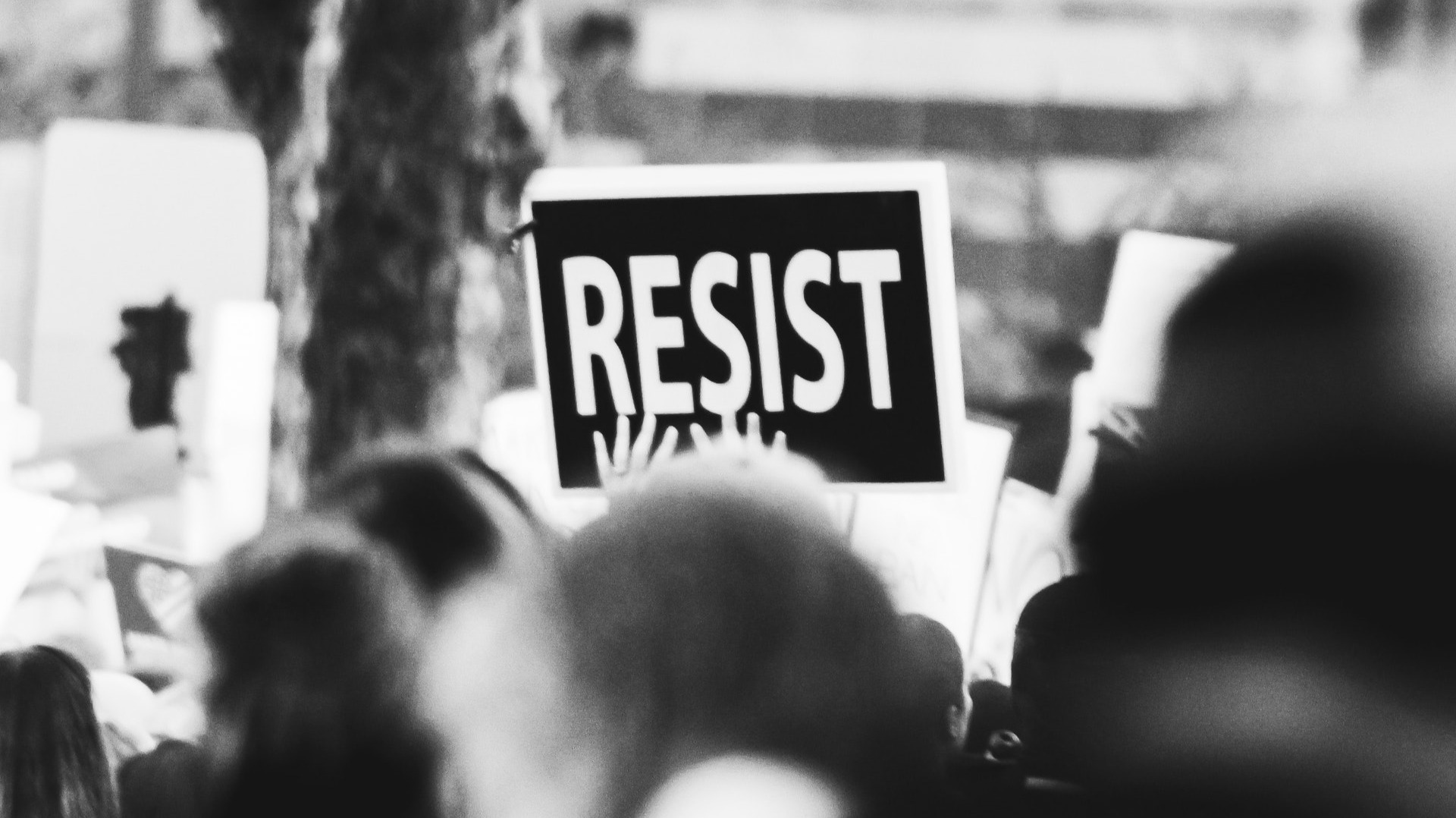 https://www.pexels.com/photo/monochrome-photo-of-resist-signage-3141240/