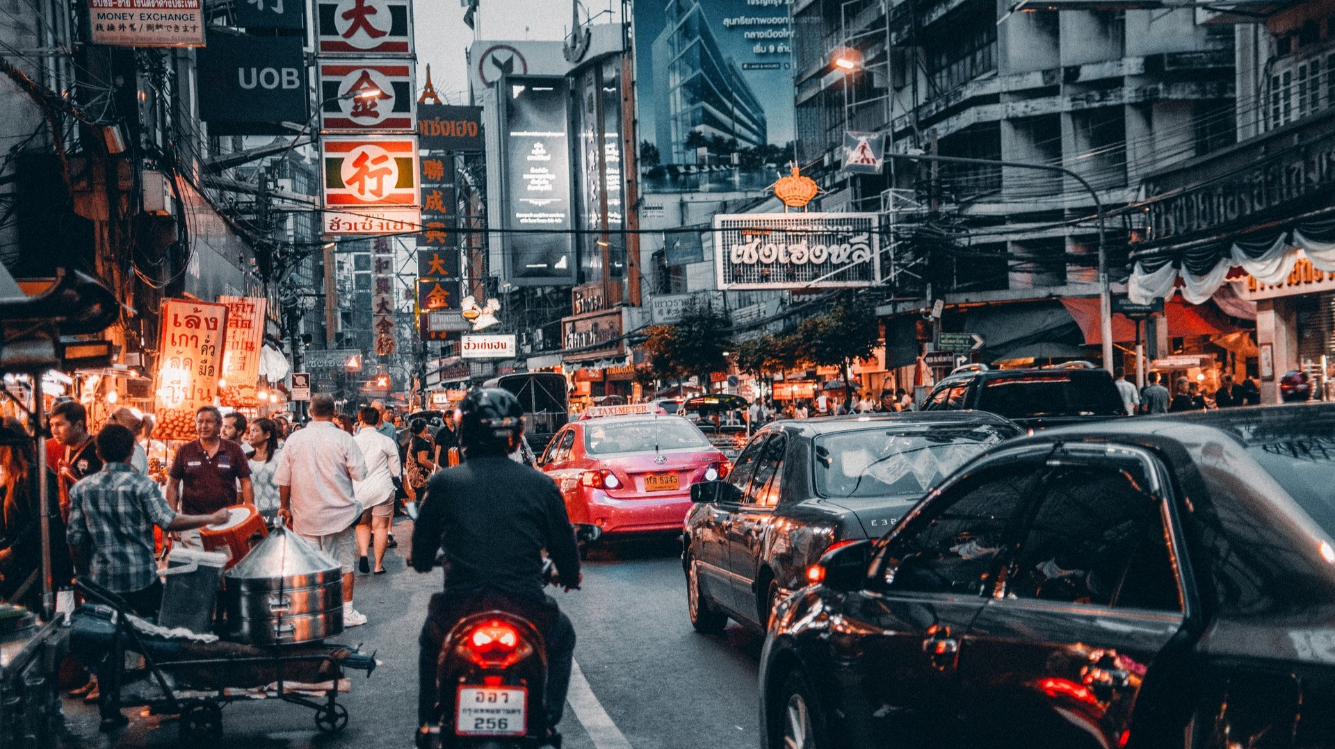https://www.pexels.com/photo/crowded-street-with-cars-passing-by-708764/