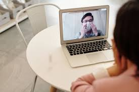 Telomedicine: A doctor comminicating to his patient via Laptop