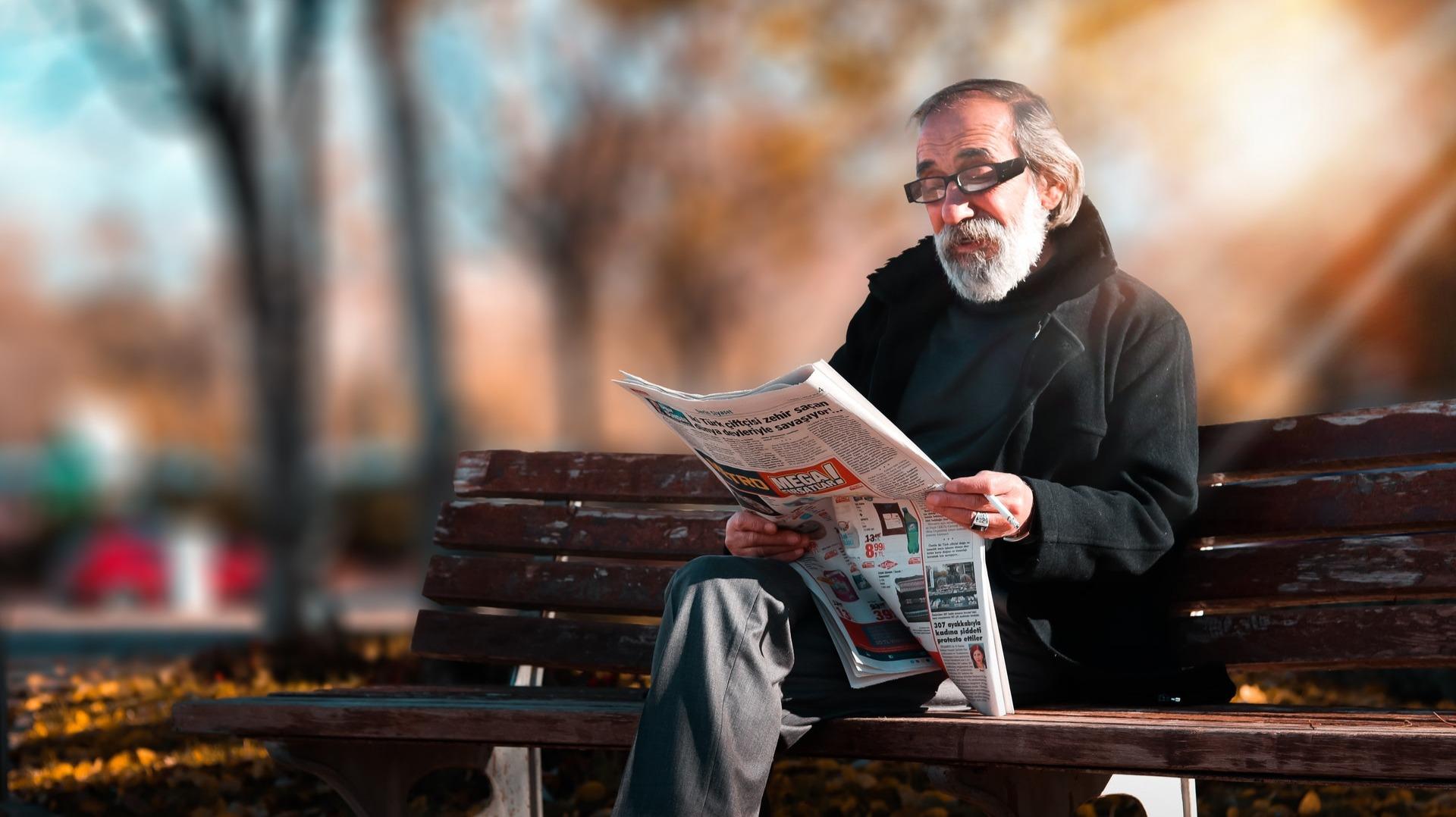 https://www.pexels.com/photo/photo-of-man-reading-newspaper-1652340/